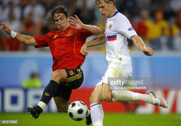 Russian midfielder Sergei Semak fights for the ball with Spanish defender Carles Puyol during the Euro 2008 Championships Group D football match...