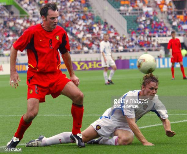 Russian midifielder Andrei Solomati falls beside Belgian midfielder Bart Goor during the Group H first round last match Belgium/Russia of the 2002...