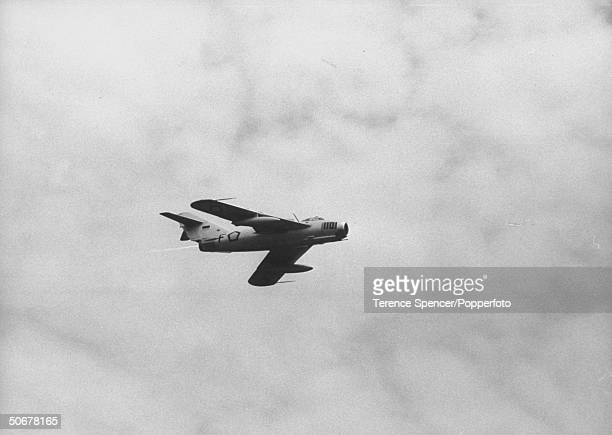Russian MIG 17 fighter aircraft flying over Makassar during Pres Sukarno's visit there