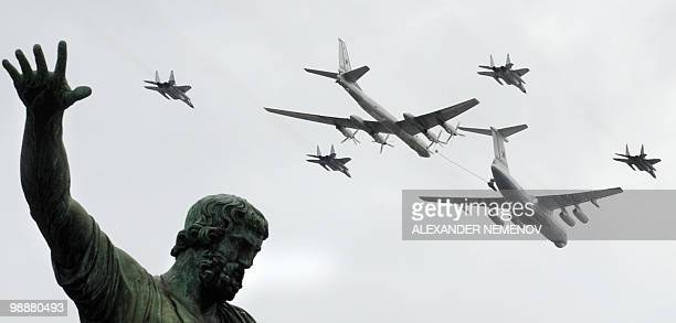 Russian MiG29 Il78 and Tu95 planes fly over a statue of Russian historical figures Minin and Pozharsky on Red Square during a Victory Day parade...