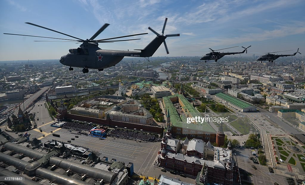 Russian Mil Mi-26 Halo helicopters fly over Red Square during the