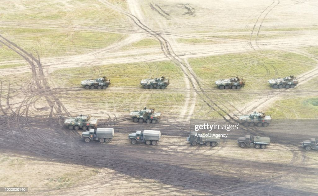 Russian military armored vehicles take part in the Vostok 2018 military exercises held jointly by the Russian Armed Forces and the Chinese People's Liberation Army at the Tsugol range in Transbaikal Territory, Russia on September 13, 2018.