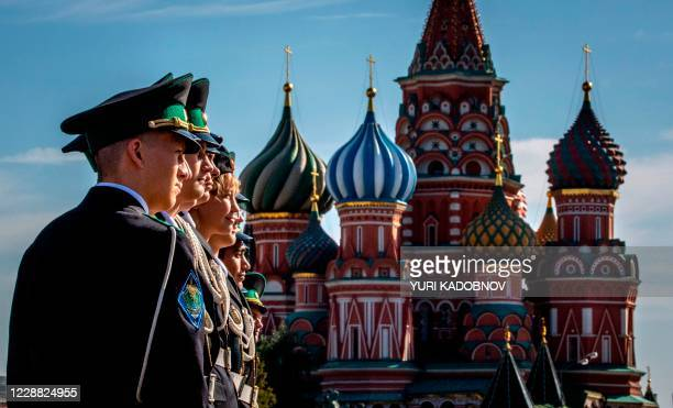 Russian military cadets pose on Red Square in front of St. Basil's Cathedral in central Moscow on October 1, 2020.