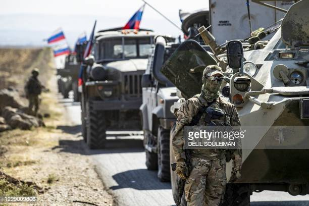 Russian Military convoy drives near the village of Ein Diwar in Syria's northeastern Hasakeh province on October 11, 2020.