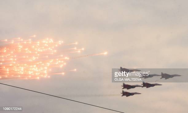 TOPSHOT Russian military jets fly during the military parade marking the 75th anniversary of the lifting of the Nazi siege of Leningrad at...