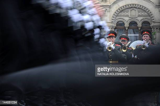 Russian military musicians play as naval infantry soldiers march during Victory Day parade at the Red Square in Moscow on May 9 2012 Thousands of...