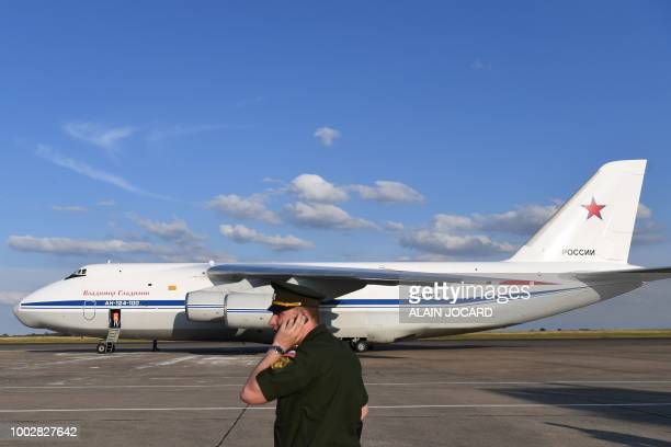 A Russian military officer stands by as an Antonov An124 Ruslan Widebody waits on the tarmac at the former ChateaurouxDeols Marcel Dassault Airport...