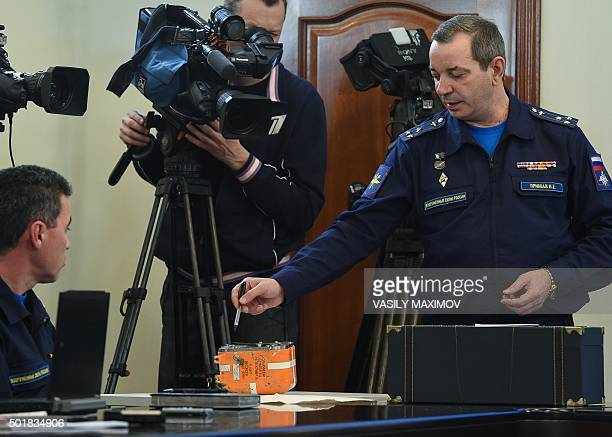 A Russian military official points to the flight recorder from the Russian Sukhoi Su24 bomber which was shot down by a Turkish jet on November 24 as...