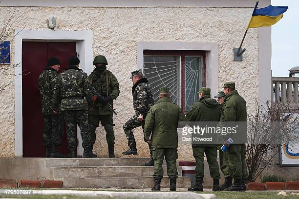 Russian military personnel surround a Ukrainian military base on March 19 2014 in Perevalnoe Ukraine Russia's Constitutional Court ruled unanimously...