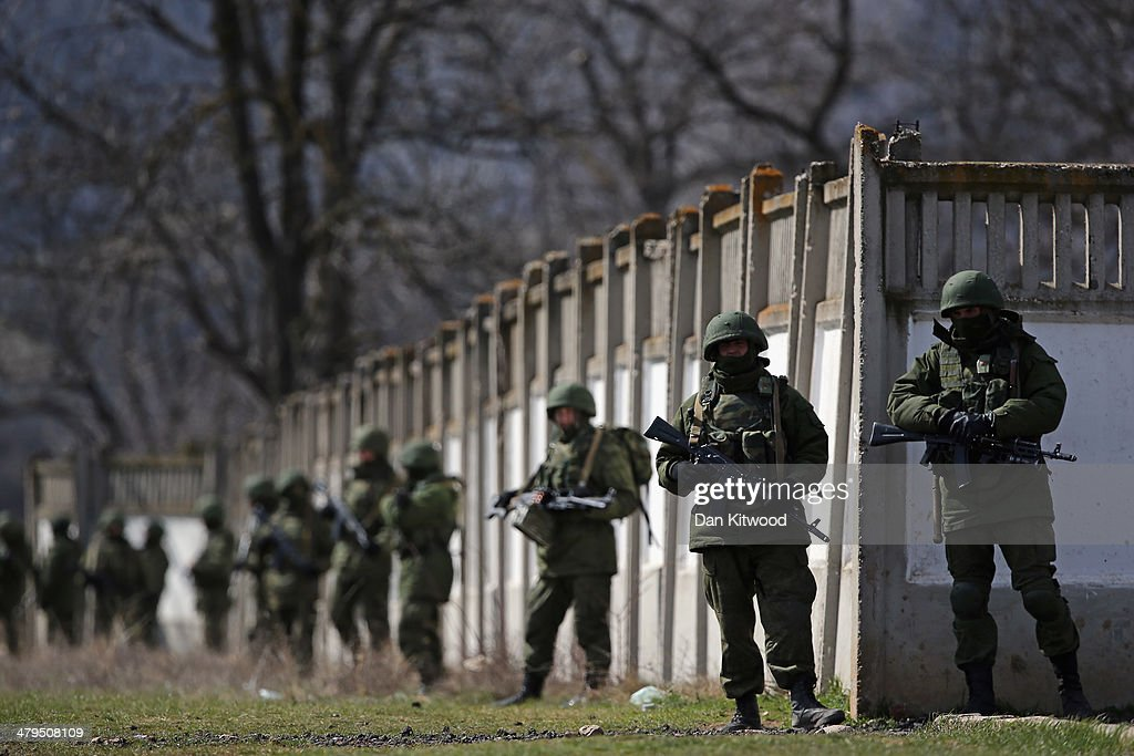 Russian military personnel surround a Ukrainian military base on March 19, 2014 in Perevalnoe, Ukraine. Russia's Constitutional Court ruled unanimously on March 19 that Russia's President Vladimir Putin acted legally by signing a treaty to make Crimea part of Russia.