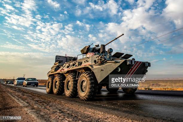 Russian military police armoured personnel carrier drives along a road in the countryside near the northeastern Syrian town of Amuda in Hasakeh...
