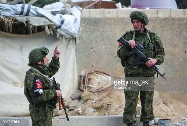 Russian military police members are seen at the Wafideen checkpoint on the outskirts of the Syrian capital Damascus neighbouring the rebelheld...