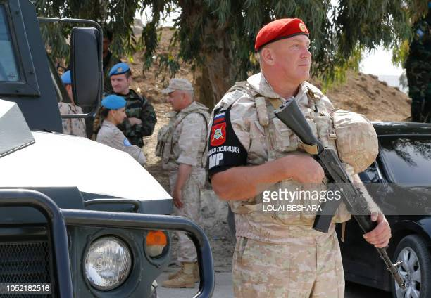 A Russian Military Police officer stands guard the Syrian part of the Quneitra border crossing to the Israeli annexedGolan Heights during its...