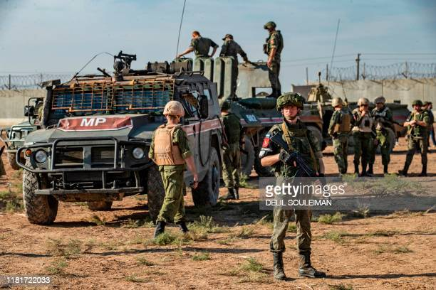 Russian military police take part in a joint TurkishRussian army patrol near the town of Darbasiyah in Syria's northeastern Hasakeh province along...