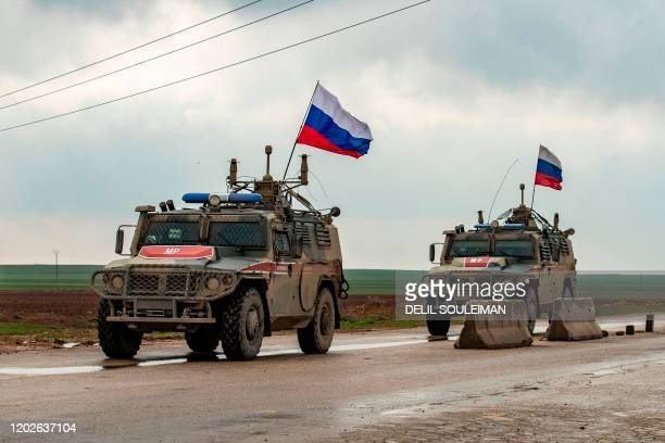 Russian military police vehicles patrol the M4 highway in the northeastern Syrian Hasakeh province on the border with Turkey, on February 22, 2020.