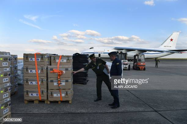 Russian military service personnel check crates containing humanitarian aid before being loaded onto an Antonov An124 Ruslan Widebody at the former...