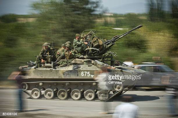 Russian military vehicle races past a Russian checkpoint on the highway which leads to the capital Tbilisi on August 18 2008 near Gori Georgia...