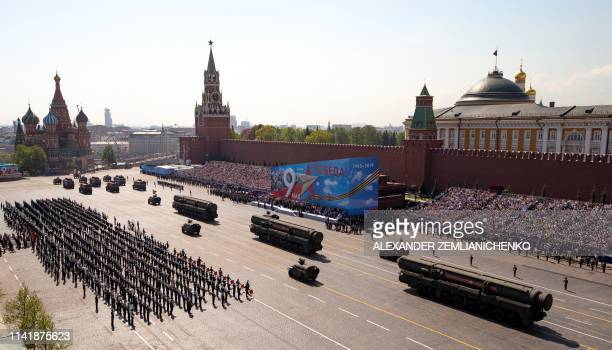 Russian military vehicles drive on Red Square in Moscow on May 7, 2019 during a rehearsal for the Victory Day military parade. - Russia will...