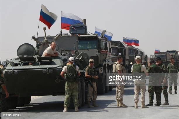 Russian military vehicles drive on the road as Russia makes a new military and logistic reinforcement of 30 vehicles to its military points in...