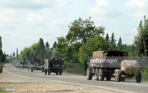 Russian military vehicles drive out of western Georgia toward the Russianheld region of Abkhazia on Friday August 22 2008 Russian authorities had...