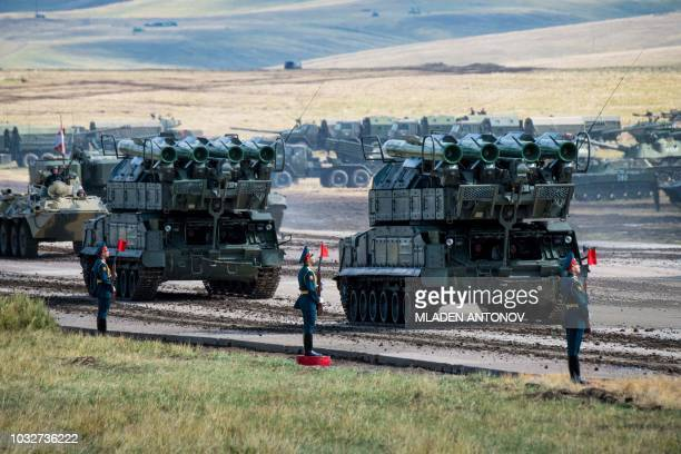 Russian military vehicles parade at the end of the day of the Vostok2018 military drills at Tsugol training ground not far from the borders with...