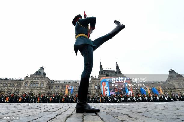 TOPSHOT Russian millitary personnel march past on Red Square in Moscow on May 6 2018 during a rehearsal for the Victory Day military parade Russia...