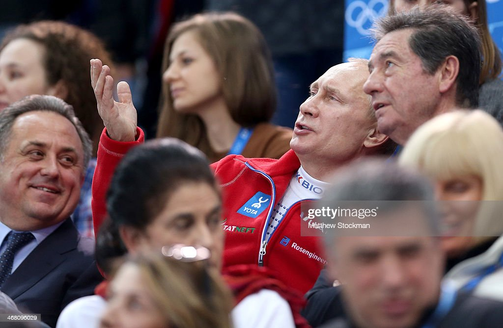 Russian Minister of Sport, Tourism and Youth policy Vitaly Mutko, Russian President Vladimir Putin and International Skating Union President Ottavio Cinquanta look on during the Team Ladies Free Skating during day one of the Sochi 2014 Winter Olympics at Iceberg Skating Palace onon February 9, 2014 in Sochi, Russia.