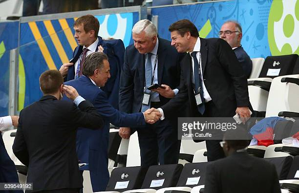Russian Minister of Sport Vitaly Mutko greets Christian Estrosi during the UEFA Euro 2016 Group B match between England and Russia at Stade Velodrome...