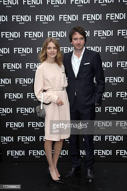 Russian model and actress Natalia Vodianova poses with her companion Antoine Arnault administrator of the LVMH group at the opening of German fashion...