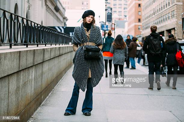 Russian model Irina Liss wears a BCBG jacket belted trench coat an oversized knit Scoop scarf belted with her coat a 31 Phillip Lim black fringe...