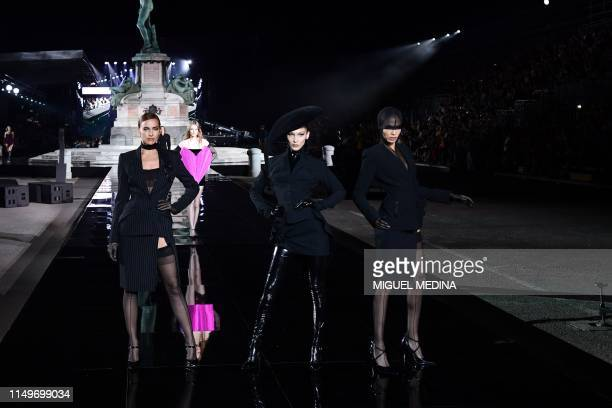 Russian model Irina Shayk and US model Bella Hadid present a creation during the presentation of French fashion editor Carine Roitfeld's CR Runway...