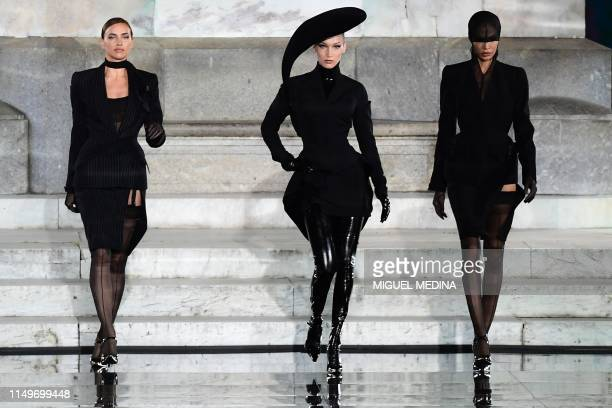 TOPSHOT Russian model Irina Shayk and US model Bella Hadid present a creation during the presentation of French fashion editor Carine Roitfeld's CR...