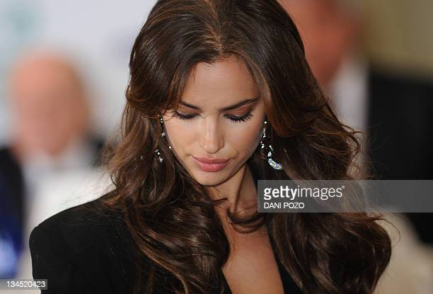 Russian model Irina Shayk girlfriend of Real Madrid's Portuguese forward Cristiano Ronaldo arrives for a ceremony in which Ronaldo will receive the...