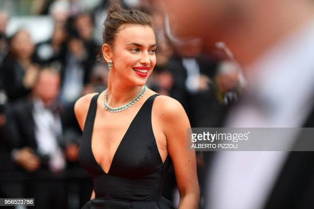 TOPSHOT Russian model Irina Shayk poses as she arrives on May 9 2018 for the screening of the film 'Yomeddine' at the 71st edition of the Cannes Film...