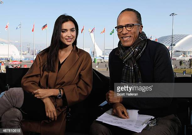 Russian model Irina Shayk poses with Lester Holt on the NBC TODAY Show set in the Olympic Park during the Sochi 2014 Winter Olympics on February 8...