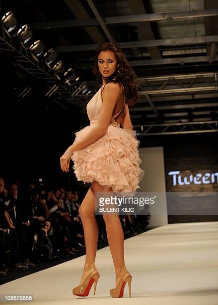 Russian model Irina Shayk presents a creation by Damat Tween at the Istanbul Fashion Week on February 4 in Istanbul The Istanbul Fashion Week runs...