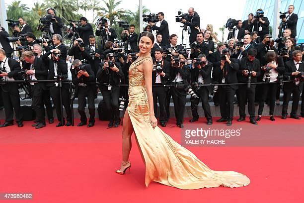 Russian model Irina Shayk smiles as she arrives for the screening of the film 'Sicario' at the 68th Cannes Film Festival in Cannes southeastern...