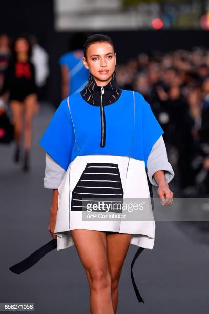 Russian model Irina Shayk takes part in the L'Oreal fashion which theme is Paris on the sidelines of the Paris Fashion Week on October 1 on a catwalk...