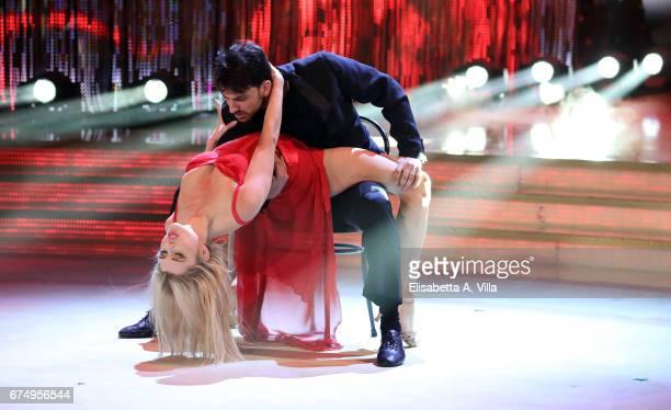 Russian model Kseniya Belousova aka Xenya and her dance partner Raimondo Todaro perform on the Italian TV show 'Ballando Con Le Stelle' at Auditorium...