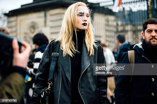 Russian model Nastya Sten exits the Margiela artisanal show in a black leather jacket and the unique Galactic gothic splendor makeup from the show by...