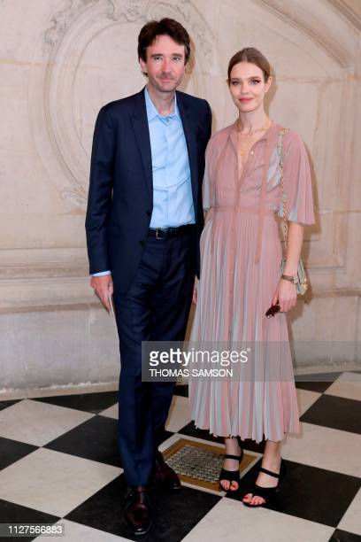 Russian model Natalia Vodianova and her husband French business man Antoine Arnault pose during a photocall prior to the FallWinter 2019/2020...