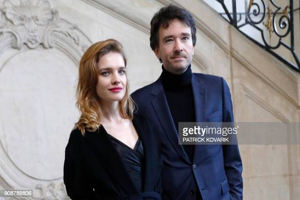 Russian model Natalia Vodianova and her husband French business man Antoine Arnault poses for a photocall prior to the Christian Dior's fashion show...