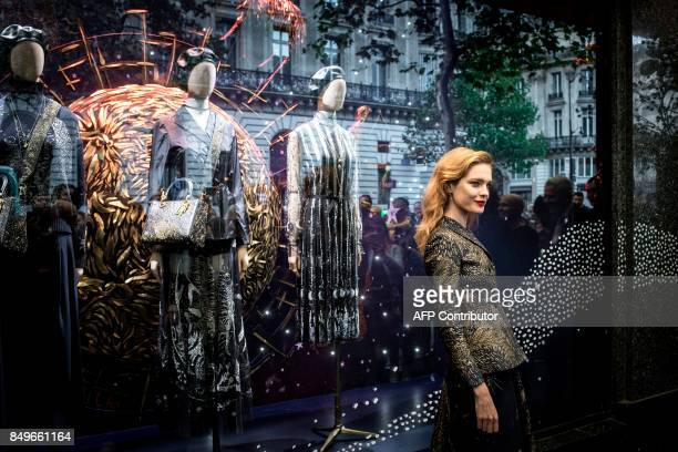 Russian model Natalia Vodianova poses before the opening of an exhibition to celebrate the 70th anniversary of the Christian Dior brand at the...