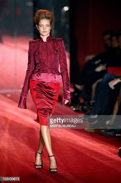 Russian model Natalia Vodianova presents a creation by US designer Tom Ford for Yves SaintLaurent during the presentation of Autumn/Winter 200405...