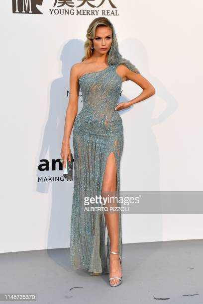 Russian model Natasha Poly poses as she arrives on May 23 2019 for the amfAR 26th Annual Cinema Against AIDS gala at the Hotel du CapEdenRoc in Cap...