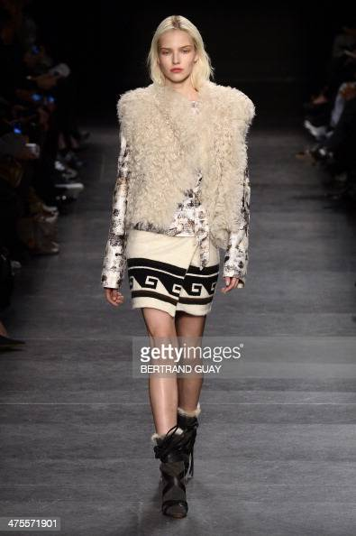 Russian model Sasha Luss presents a creation by Elie Saab