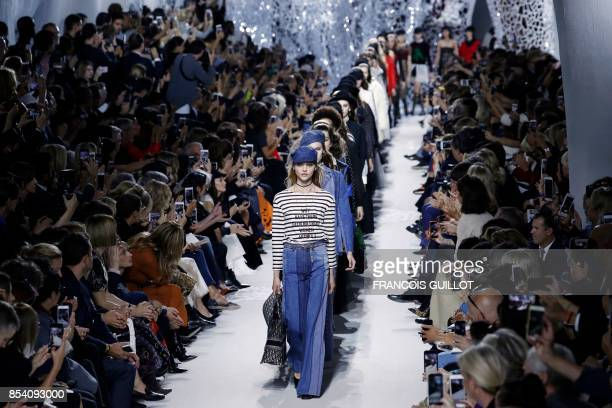 TOPSHOT Russian model Sasha Pivovarova leads models presenting creations for Christian Dior during the women's 2018 Spring/Summer readytowear...