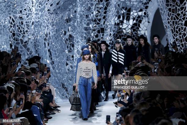 Russian model Sasha Pivovarova leads models presenting creations for Christian Dior during the women's 2018 Spring/Summer readytowear collection...