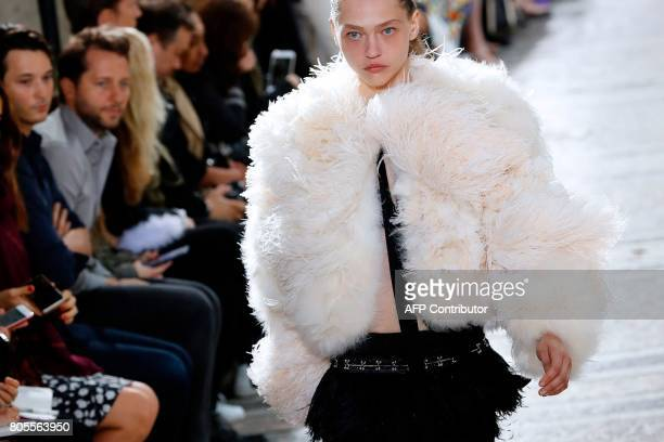Russian model Sasha Pivovarova presents a creation for Proenza Schouler during the 20172018 fall/winter Haute Couture collection in Paris on July 2...