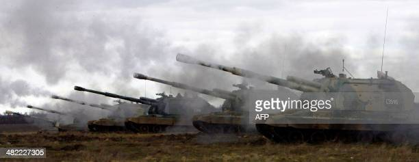 Russian Msta-S self-propelled howitzers fire during military exercises in the southern Russia's Volgograd region, on April 2, 2014. Russian troops...